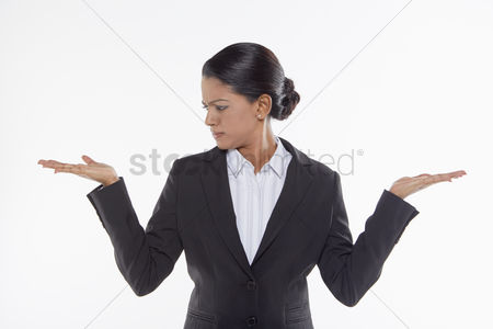Frowning : Businesswoman showing hand gesture  facing right