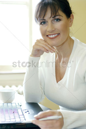Smile : Businesswoman sitting in front of a laptop