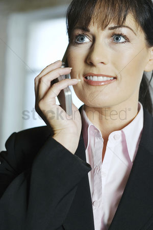 Cellular phone : Businesswoman smiling while talking on the phone