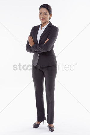 Malaysian indian : Businesswoman smiling with arms crossed