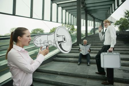 Cardboard cutout : Businesswoman speaking through megaphone