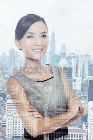 China : Businesswoman standing against a cityscape background