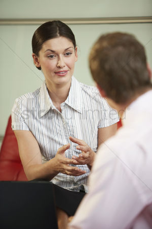 Interior background : Businesswoman talking in meeting close-up