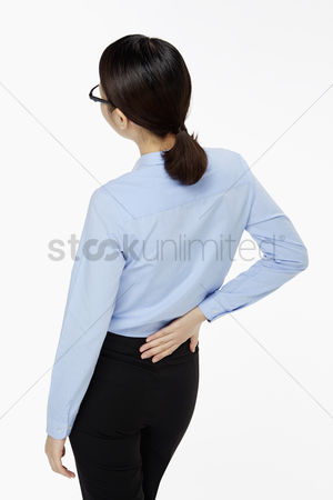 Ache : Businesswoman touching her lower back
