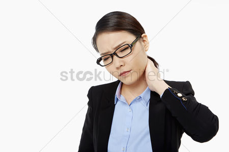 Frowning : Businesswoman touching her neck