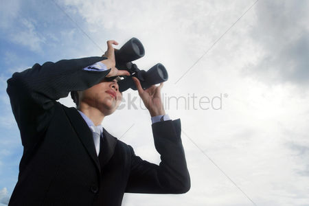 Relaxing : Businesswoman using binoculars