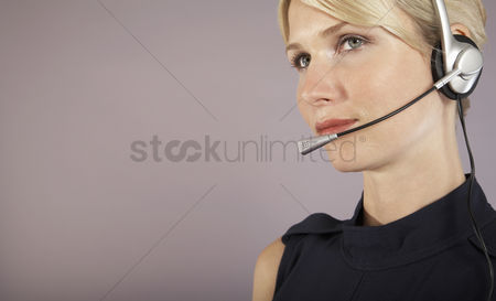 Office worker : Businesswoman wearing headset close-up portrait