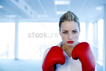 Sales person : Businesswoman wearing red boxing gloves