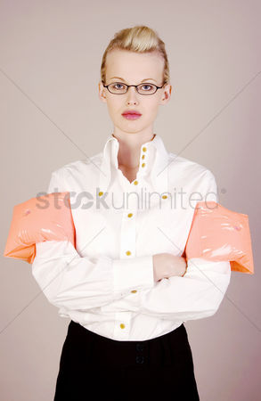Composed : Businesswoman wearing swimming float on her arms