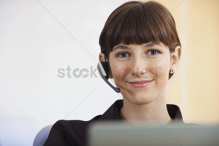 Camera : Businesswoman wearing telephone headset portrait