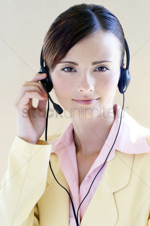 Answering calls : Businesswoman wearing telephone headset
