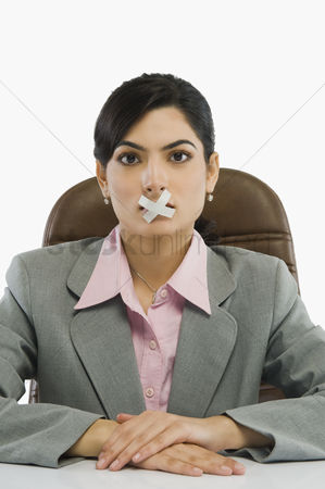 Forbidden : Businesswoman with adhesive tape over her mouth