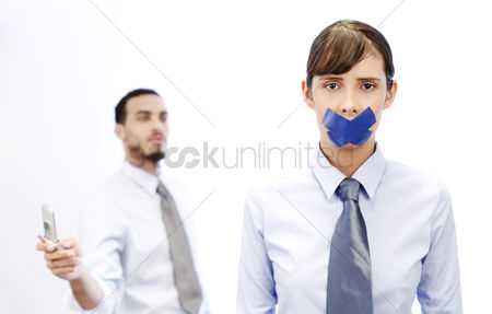 Sales person : Businesswoman with her lips sealed while her colleague is making phone call