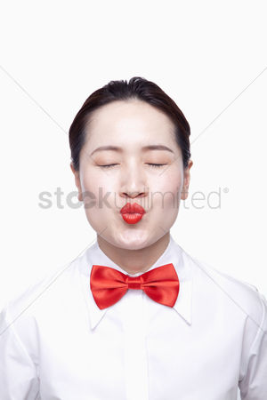 Kissing : Businesswoman with red tie  kissing face