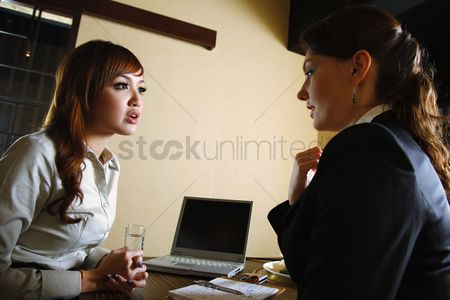 Eastern european ethnicity : Businesswomen having discussion over lunch