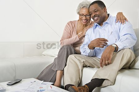 Husband : Cheerful senior couple on couch