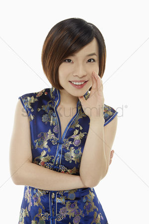 Lunar new year : Cheerful woman in traditional clothing showing a whispering hand gesture