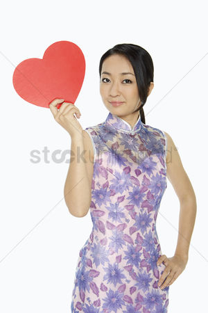 Lunar new year : Cheerful woman with a red heart