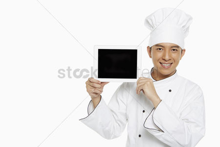 Masculinity : Chef holding up a digital tablet