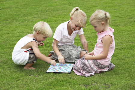 School children : Children playing board game