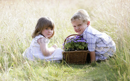 First : Children with a basket of flowers