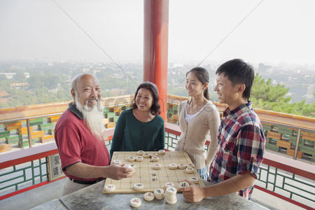 Forbidden : Chinese family playing chinese chess  xiang qi