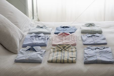 Obsessive : Clean shirts ordered on a bed