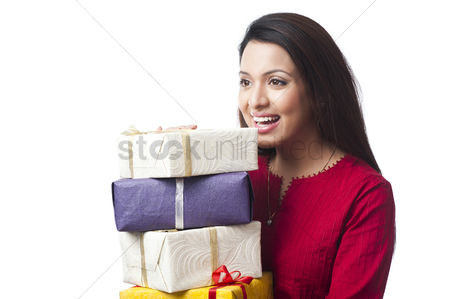 Housewife : Close-up of a happy woman holding a stack of gifts