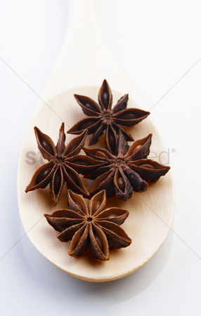Star : Close up of anise on wooden spoon