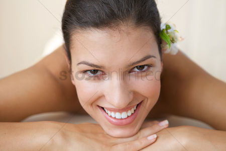 Spa : Close-up of cheerful young woman relaxing on massage table