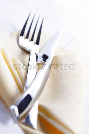 Collection : Close up of fork and knife lies on cloth