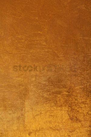 Abstract : Close-up of gold wallpaper