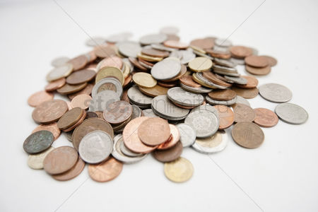 Pile : Close-up of large group of coins over white background