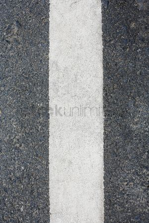 Weathered : Close-up of line on road