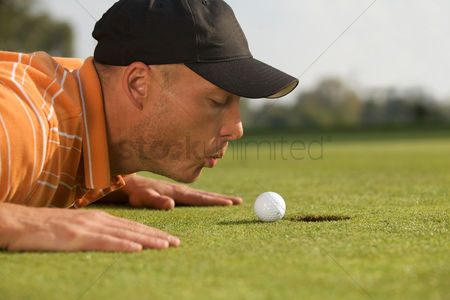 Blowing : Close-up of man blowing on golf ball