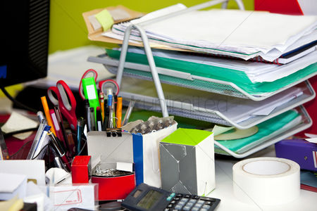 Furniture : Close-up of real life messy desk in  office