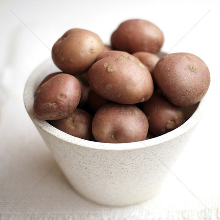 Food  beverage : Close up of some red potatoes in a bowl