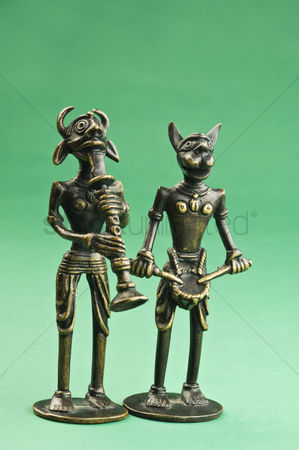 Animal : Close-up of two figurines depicting tribal people with animal head