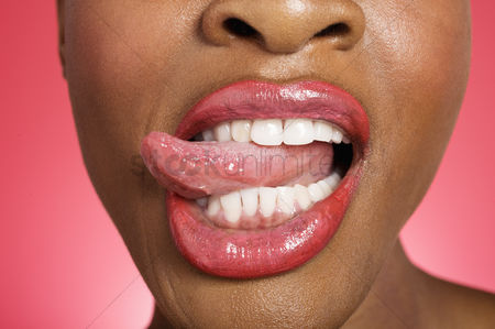 Funny : Close up of woman sticking out tongue