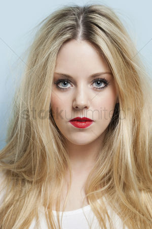 Head shot : Close-up portrait of beautiful young woman with blond hair and red lips