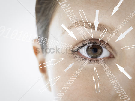 Businesswomen : Close-up portrait of businesswoman with binary digits and arrow signs moving towards her eye against white background