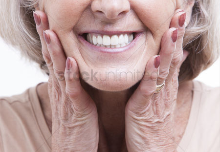 Senior women : Close up view on senior dentures