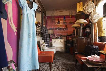 Hand : Clothing and furniture in crowded second hand store