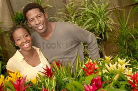 Greenhouse : Couple among plants at nursery  portrait