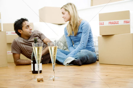 Relaxing : Couple celebrating in their new house
