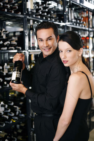 Advice : Couple choosing wine in the wine cellar