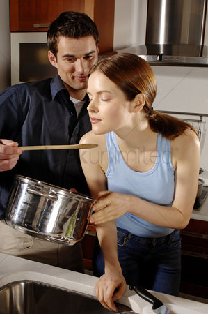 Girlfriend : Couple cooking in the kitchen