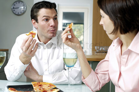 Celebrating : Couple eating pizza together