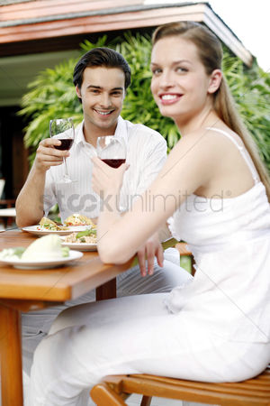 Toasting : Couple enjoying their meal in the garden