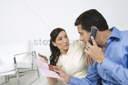 Cell phone : Couple holding credit cards